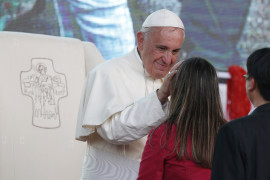 Pope Francis greets a young woman as he leads a meeting with young people along the waterfront in Asuncion, Paraguay, July 12. (CNS photo/Paul Haring) See VATICAN-LETTER July 16, 2015.
