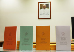 """Copies of Pope Francis' apostolic exhortation on the family, """"Amoris Laetitia"""" (""""The Joy of Love""""), are seen during the document's release at the Vatican April 8. The exhortation is the concluding document of the 2014 and 2015 synods of bishops on the family. (CNS photo/Paul Haring) See POPE-FAMILY-EXHORTATION and VATICAN-LETTER-FAMILY April 8, 2016."""