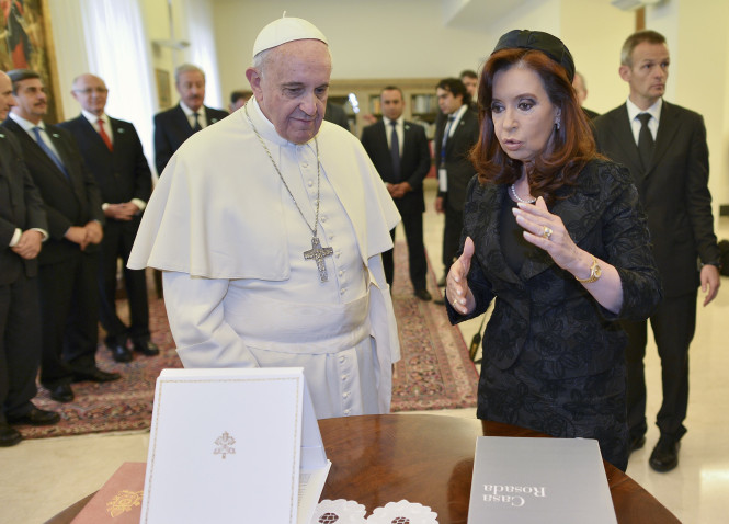 Pope Francis and Argentina's President Cristina Fernandez de Kirchner exchange gifts during a private audience at the Vatican March 17. (CNS photo/Alberto Pizzoli, pool via Reuters) (March 17, 2014)