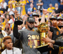 OAKLAND, CA - JUNE 19: LeBron James #23 of the Cleveland Cavaliers gets handles the NBA championship trophy against the Golden State Warriors during the 2016 NBA Finals Game Seven on June 19, 2016 at ORACLE Arena in Oakland, California. NOTE TO USER: User expressly acknowledges and agrees that, by downloading and or using this photograph, User is consenting to the terms and conditions of the Getty Images License Agreement. Mandatory Copyright Notice: Copyright 2016 NBAE (Photo by Jesse D. Garrabrant/NBAE via Getty Images)