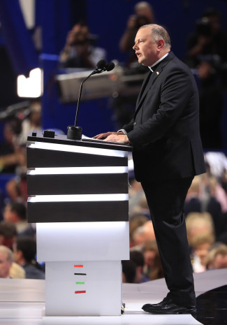 Msgr. Kieran Harrington, vicar of communications for the Diocese of Brooklyn, N.Y., delivers the invocation July 18 during the first day of the 2016 Republican National Convention in Cleveland. (CNS photo/Tannen Maury, EPA)