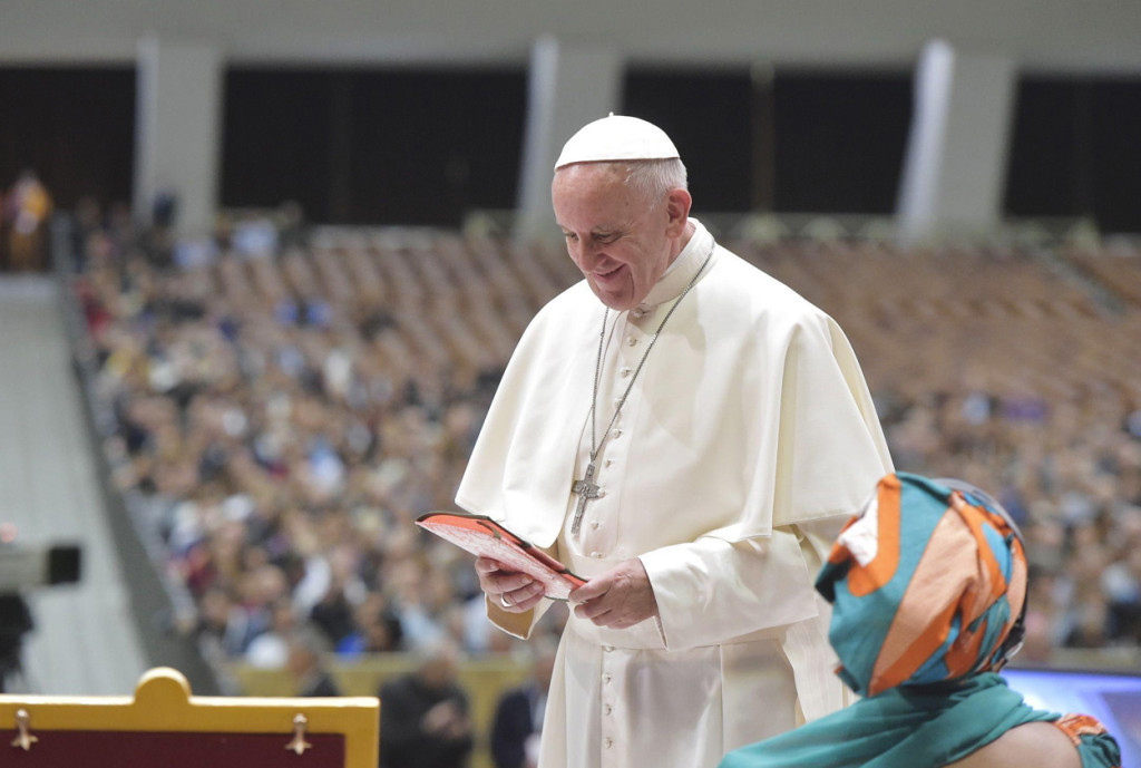 Pope Francis attends a Nov. 5 meeting at the Vatican with participants in the third World Meeting of Popular Movements, a collection of grass-roots organizations of the poor, the underemployed, indigenous communities and farmworkers. (CNS photo/L'Osservatore Romano via EPA) See POPE-POPULAR-MOVEMENTS Nov. 5 2016.