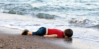 Aylan Kurdit, a 3-year old migrant from Syria, who drowned in a failed attempt to sail to the Greek island of Kos, lies on the shore Sept. 2 in the Turkish coastal town of Bodrum. (CNS photo/Reuters) See MIGRANTS-EUROPE-NICHOLS Sept. 3, 2015. Editors: Be advised of graphic content. Editorial use only.