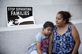 A mother and daughter in Los Angeles react after the U.S. Supreme Court issued a split ruling June 23 blocking President Barack Obama's executive actions to temporarily stop deportations. (CNS photo/Eugene Garcia, EPA) See ADVOCATES-IMMIGRATION-NEXT July 1, 2016.