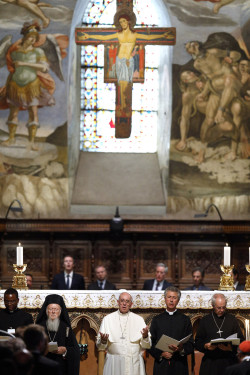 Ecumenical Patriarch Bartholomew of Constantinople, Pope Francis, an unidentified clergyman and Anglican Archbishop Justin Welby of Canterbury, England, attend an ecumenical prayer service with other religious leaders in the Basilica of St. Francis in Assisi, Italy, Sept. 20. The pope and other religious leaders participated in the service that marked the 30th anniversary of St. John Paul IIís Assisi interfaith peace gathering. (CNS photo/Paul Haring) See ASSISI-ECUMENISM-WELBY, ASSISI-BARTHOLOMEW-TRIBUTE, ASSISI-CHRISTIAN-PRAYER, POPE-ASSISI-PEACE Sept. 20, 2016.