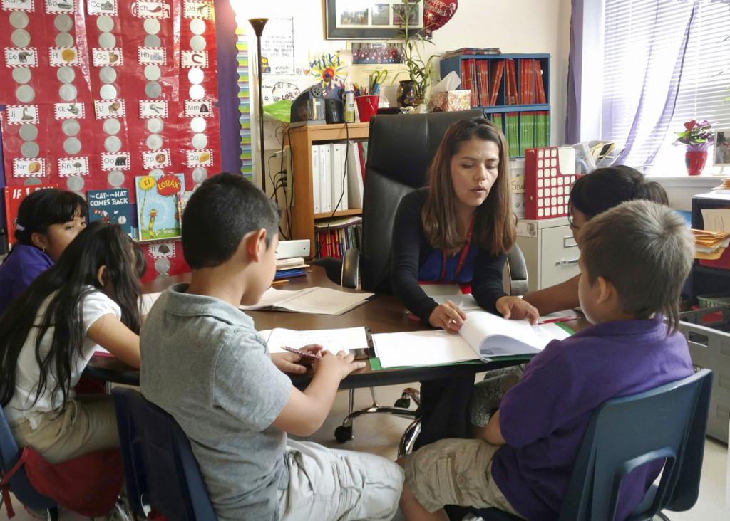 Teacher Maria Dominguez works with students at Rodriguez Elementary School in Austin, Texas. Dominguez said there is fear and anxiety among her students and their parents, many of whom are in the country illegally, over the Trump administration's immigration proposals.(CNS photo/courtesy Maria Dominguez) See IMMIGRATION-TEACHER-DOMINGUEZ Feb. 10, 2017.
