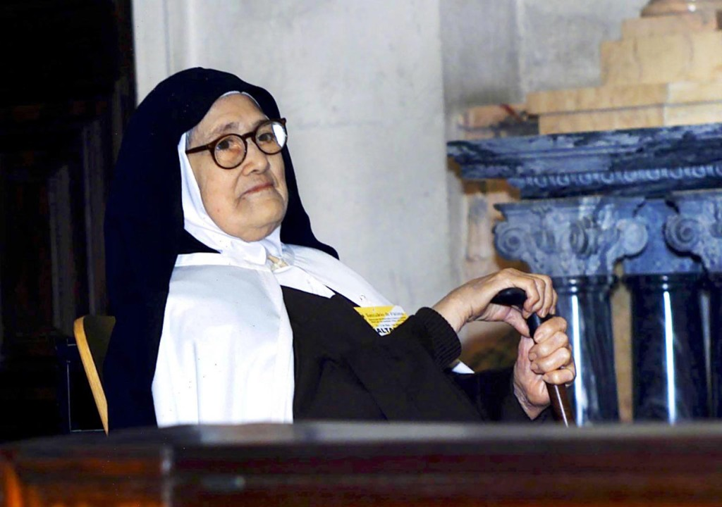 Sister Lucia dos Santos, one of the three children who saw Our Lady of Fatima in 1917, is pictured in a 2000 photo. Bishop Virgilio Antunes of Coimbra, Portugal, formally closed the local phase of investigation into her life and holiness Feb. 13 in the Carmelite convent of St. Teresa in Coimbra, where she resided until her death in 2005 at the age of 97. (CNS photo/Paulo Carrico, EPA) See FATIMA-LUCIA-CAUSE Feb. 14, 2017.