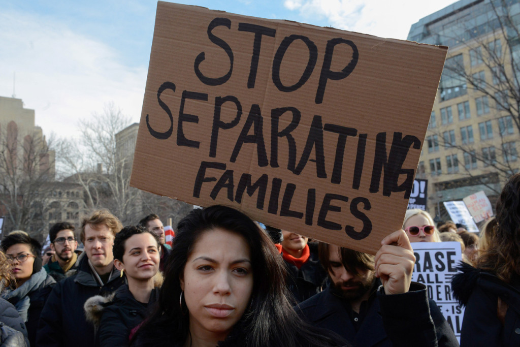 People participate in a protest Feb. 11 against U.S. President Donald Trump's immigration policy and the recent Immigration and Customs Enforcement raids in New York City. (CNS photo/Stephanie Keith, Reuters) See WASHINGTON-LETTER-CRACKDOWN Feb. 17, 2017.