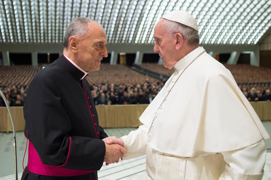 Pope Francis greets Msgr. Pio Vito Pinto, dean of the Roman Rota, during an audience with participants in a course on marriage annulment changes in Paul VI hall at the Vatican March 12. The course focused on changes Pope Francis approved last September in regard to marriage annulments. The Roman Rota is a Vatican court that deals mainly with marriage cases. (CNS photo/L'Osservatore Romano) See POPE-ROTA-MARRIAGE March 15, 2016.