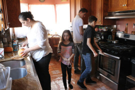 Gloria Sanchez, left, with her children, Gloria, 8, Leo, 14 and Eduardo, 12, are seen in the kitchen of their home Feb. 16 in Modesto, Calif. Sanchez, a leader with the faith-based group Congregations Building Community, and her husband, Leopoldo Sandoval, are in the United States without legal permission and could be detained by federal agents and deported, leaving the children by themselves. (CNS photo/Dennis Sadowski) See CONGREGATIONS-COMMUNITY-JUSTICE Feb. 27, 2017.