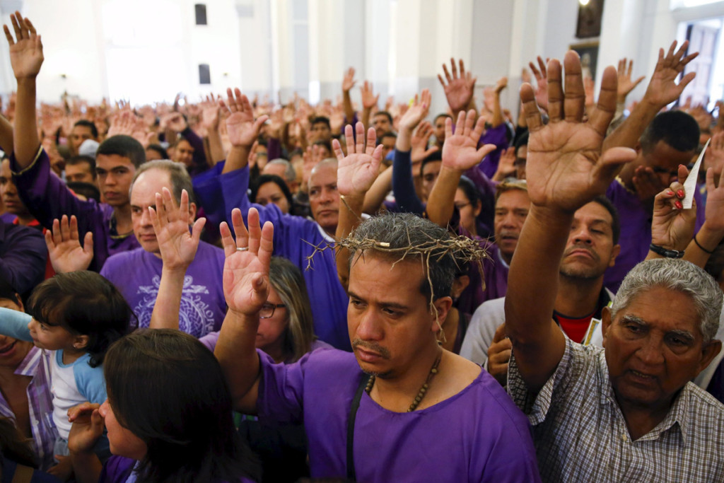 Worshippers attend Mass April 1 at St. Teresa's Basilica as part of Holy Week celebrations in Caracas, Venezuela. (CNS photo/Carlos Garcia Rawlins, Reuters)
