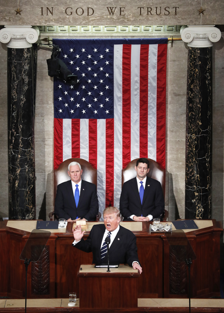 Vice President Mike Pence and U.S. House Speaker Paul Ryan, R-Wis., look on as President Donald Trump delivers his first address to a joint session of Congress Feb. 28 in Washington. (CNS photo/Michael Reynolds, EPA)