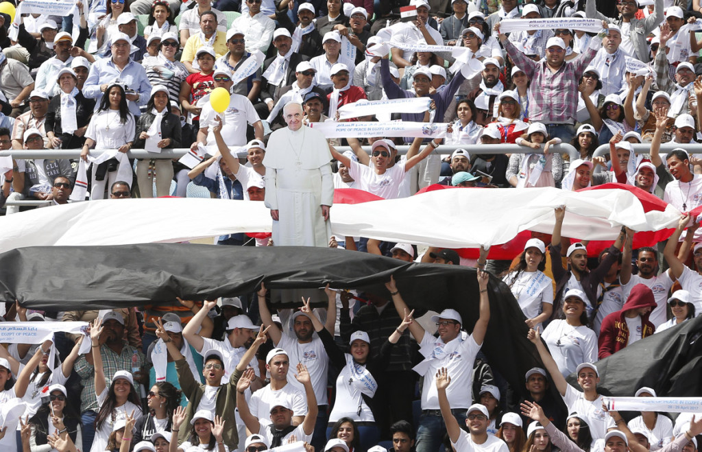 The crowd reacts as Pope Francis arrives to celebrate Mass at the Air Defense Stadium in Cairo April 29. (CNS photo/Paul Haring) See POPE-EGYPT-MASS April 29, 2017.