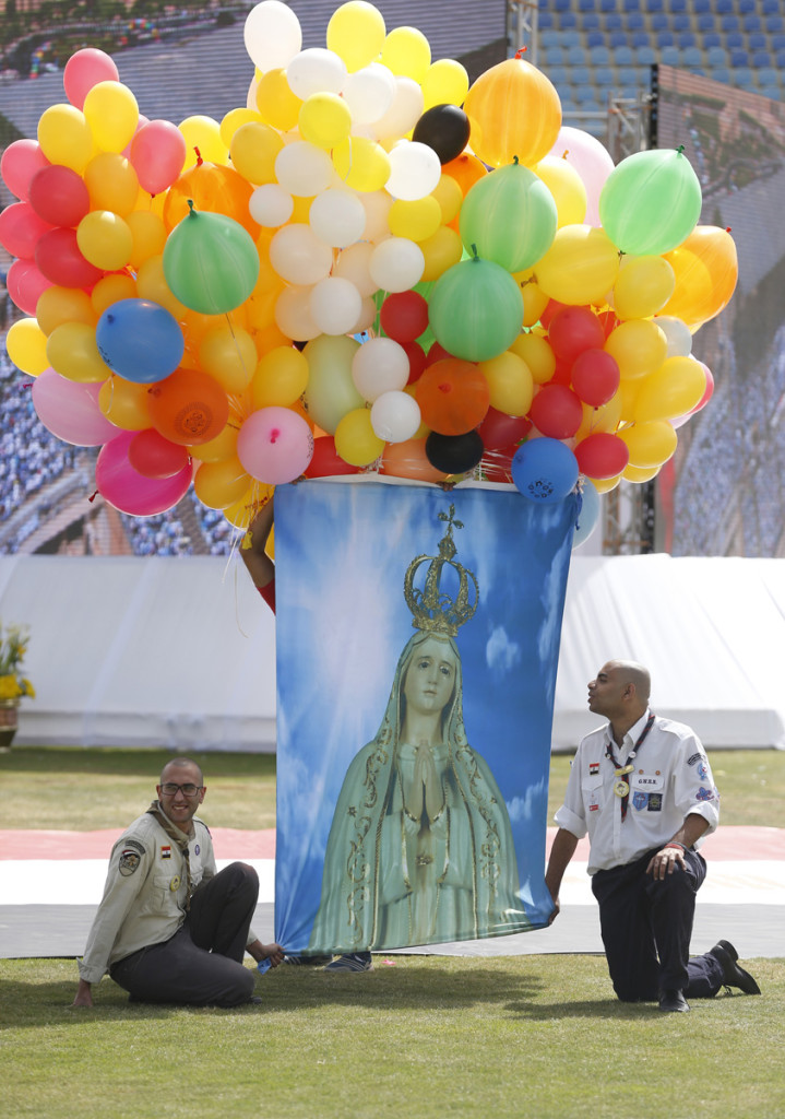 Balloons are attached to an image of Mary as people wait for the start of Pope Francis' celebration of Mass at the Air Defense Stadium in Cairo April 29. (CNS photo/Paul Haring) See POPE-EGYPT-MASS April 29, 2017.