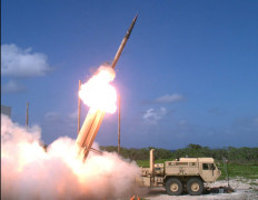 A Terminal High Altitude Area Defense (THAAD) interceptor is launched from a THAAD battery located on Wake Island, during Flight Test Operational (FTO)-02 Event 2a, conducted Nov. 1, 2015.  During the test, the THAAD system successfully intercepted two air-launched ballistic missile targets.