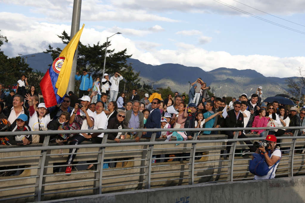 People wait for Pope Francis upon his arrival in Bogota, Colombia, Sept. 6. (CNS photo/Paul Haring) See POPE-COLOMBIA-ARRIVE Sept. 6, 2017.