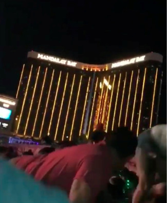 People at the Route 91 Harvest Music Festival in Las Vegas are seen crouching down Oct. 1 as a gunman opens fire from the 32nd floor of the Mandalay Bay Resort and Casino. The still image is from a social media video. The gunman killed at least 58 people and wounded more than 500 before law enforcement entered the shooter's room and killed him. (CNS photo/social media via Reuters) See LAS-VEGAS-MASS-SHOOTING-PRAYERS Oct. 2, 2017. Editors: best quality available.