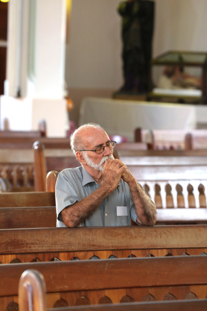 A man prays after Mass at St. Rafael the Archangel Church Oct. 22 in Quebradillas, Puerto Rico. The majority of the town has been without power or water for more than a month after Hurricane Maria devastated the island. (CNS photo/Bob Roller) See stories slugged PUERTO-RICO-RECOVERY Oct. 23, 2017, and to come.